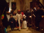 Children leading the way to the altar