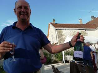 Philippe Talbot, deputy mayor of Essoyes, serving champagne.